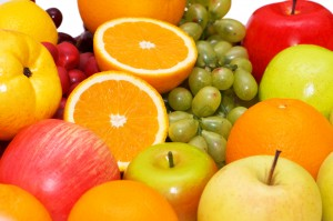 Various colourful fruits arranged on the tray